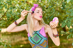 Beauty woman primping in park, lifestyle, people. Beauty portrait stylish playful woman primping with mirror in park, people, outdoors. Attractive hipster happy stock image
