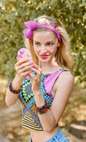 Beauty woman primping in park, lifestyle, people. Beauty portrait stylish playful woman smiling primping with mirror, park, people, outdoors. Attractive hipster stock image
