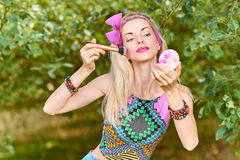 Beauty woman primping in park, lifestyle, people. Beauty portrait stylish playful woman smiling primping with mirror, park, people, outdoors. Attractive hipster stock photo