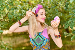 Beauty woman primping in park, lifestyle, people. Beauty portrait stylish playful woman smiling primping with mirror, park, people, outdoors. Attractive hipster royalty free stock photography