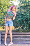 Beauty woman primping in park, lifestyle, people. Beauty stylish playful woman on bench, park, people, outdoors.Attractive hipster happy pretty blonde girl with royalty free stock images