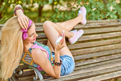 Beauty woman primping in park, lifestyle, people. Beauty stylish playful woman smiling primping with mirror, park, people, outdoors.Attractive hipster happy royalty free stock images