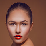 Beauty woman with professional make up in studio. On brown background Royalty Free Stock Image