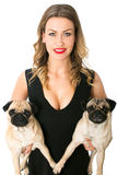 Beauty woman with pugs Stock Photos