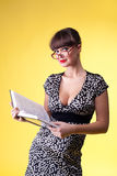 Beauty woman read smart book - pinup style Stock Photos