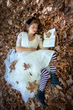 Beauty woman reading relaxing Royalty Free Stock Photography