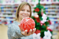 Beauty woman with red ball for the Christmas tree Stock Photos