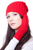 Beauty woman in a red cap and mittens Stock Photos
