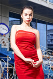 Beauty woman in red dress in the city Stock Images