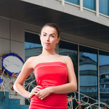 Beauty woman in red dress in the city Royalty Free Stock Photos