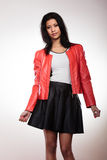 Beauty woman in red jacket Stock Images