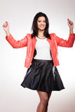 Beauty woman in red jacket. Fashion and style. Beauty gorgeous young mixed race woman wearing stylish red jacket coat and black leather skirt. Fashionable girl Royalty Free Stock Photography