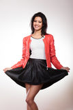 Beauty woman in red jacket Royalty Free Stock Image