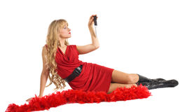 Beauty woman in red play with blade Stock Images