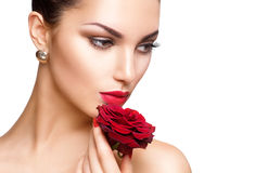 Beauty woman with red rose. Isolated on white background Stock Photos