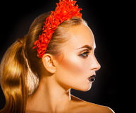 Beauty woman with red wreath and makeup on black background Royalty Free Stock Photography