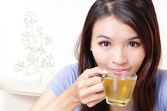 Beauty woman relax drink tea with home background Royalty Free Stock Image