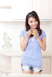 Beauty woman relax drink tea with home background. Happy Young Girl relax drink tea with home background, model is a asian beauty Stock Photo