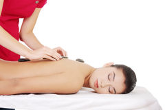 Stone massage. Royalty Free Stock Photo