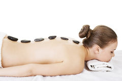 Beauty woman relaxing in spa. Stone massage. Isolateed royalty free stock image