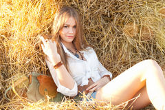 Beauty woman relaxing in the straw in field Royalty Free Stock Photography