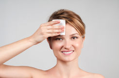 Beauty. Woman removing makeup with cotton pad. royalty free stock photos