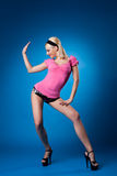 Beauty woman in rose dance on blue background Royalty Free Stock Photos
