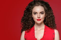 Beauty woman with rose flower beautiful curly hair and lips stock photography