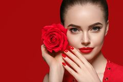 Beauty woman with rose flower beautiful curly hair and lips stock photo