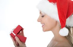 Beauty woman in  Santa hat with present Stock Photos