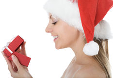 Beauty woman in  Santa hat with present Royalty Free Stock Images