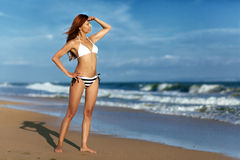 Beauty woman on sea beach Royalty Free Stock Photography