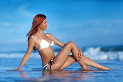 Beauty woman on sea beach Stock Photo
