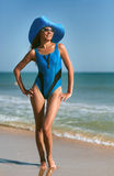 Beauty woman on sea beach Stock Images
