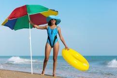 Beauty woman on sea beach Stock Photos