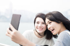 Beauty woman selfie in hongkong. Two beauty women smile happily and selfie in hongkong stock photo