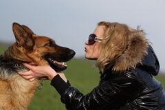 Beauty woman and shepherd. She is beauty woman and shepherd Royalty Free Stock Images