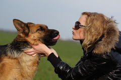 Beauty woman and shepherd. She is beauty woman and shepherd Royalty Free Stock Image