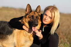 Beauty woman and shepherd Royalty Free Stock Images