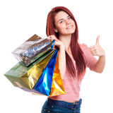 Beauty Woman with Shopping Bags in Shopping Mall. Stock Image