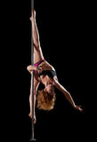 Beauty woman show split in pole dance Stock Photography