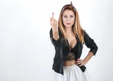 Beauty woman showing middle finger. Woman rude gesture Stock Images
