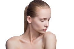 Beauty woman shyly looking down on white. Beauty woman with perfect skin Stock Photo