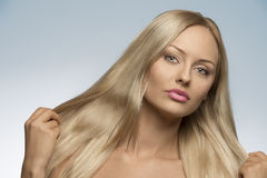 Beauty woman with silky hair Stock Images