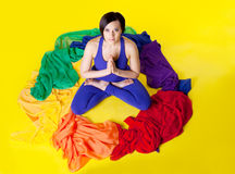 Beauty woman sit in color ring - yoga pose Royalty Free Stock Photo