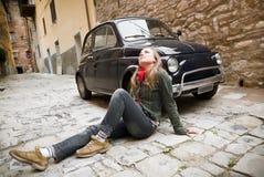Beauty Woman Sitting Against Retro Car Stock Photo