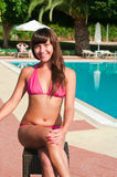 Beauty woman sitting near pool Royalty Free Stock Images