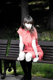 Beauty Woman Sitting On A Park Bench Stock Photo