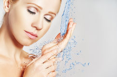 Beauty woman skin care, washing with splashes of water Stock Image