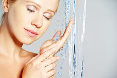 Beauty woman skin care, washing with splashes of water Stock Photography